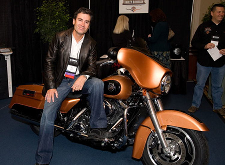 Ken Schmidt, Harley-Davidson marketing guru and keynote speaker, sitting astride the top giveaway at the eCopy Paper Connection Forum 2008 (Westin Hotel, Boston)